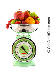 Scale with fruit for diet - Kitchen scale with a diversity...
