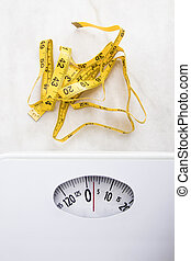 scale with tape measure, concept of weight loss and diet