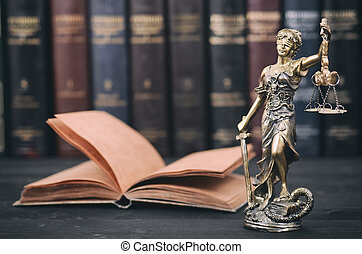 Scales of Justice, Justitia, Lady Justice and Law books in the background.