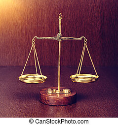 scales on wooden table, law concept
