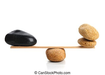 scales with zen stone isolated on white showing balance or ...