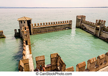 Scaliger Castle extending over the Garda Lake, Sirmione, Italy