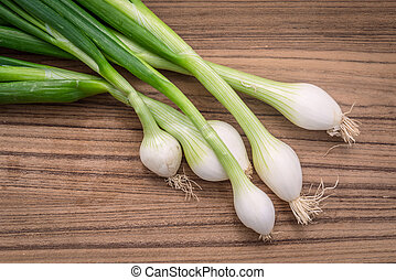 Scallions on a wooden board