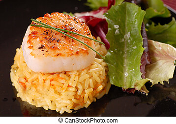 Scallop on bed of saffron rice with salad