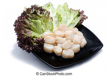Scallops with salad on black plate