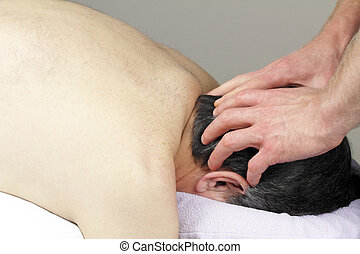 Scalp Massage - Mature man with graying black hair face down...
