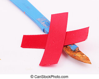 scalpel - A rusty scalpel with blue handle and Red Cross