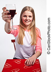 Scandinavian cute young girl holding a glass of wine in the air