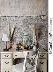 scandinavian decoration for cozy home made with dry herbs, lamp, candles and garlands on concrete background. Dried flowers and vegetation in a modern interior. Interior decor in eco-style