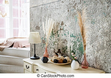 scandinavian decoration on concrete background. Dried flowers and vegetation in a modern interior. Interior decor in eco-style with greenery. home interior. Scandinavian cozy light interior of living room.