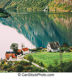 Scandinavian houses on shore of the narrowest fjord in Norway - Naeroyfjord
