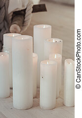 scandinavian still life with big white candles. textured and...