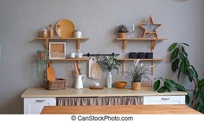 Scandinavian-style kitchen interior. minimalist and light interior. design of the photo studio. furniture made of wood.