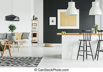 Scandinavian style open space - Gold painting on black wall...