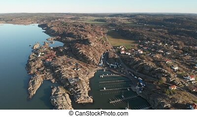 Scandinavian West Coast Harbour and Village, Aerial Pan Right. High quality 4k footage
