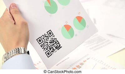 Scanning advertising with quick response code on mobile smartphone.