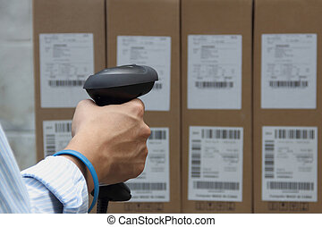 Scanning the label on the boxes with barcode scanner