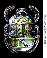 scarab with gems isolated on black background