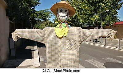 A funny scarecrow in a Italian country street near Rome, Italy, in a windy, sunny day