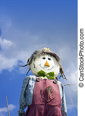 Scarecrow - A smiling hand made scarecrow stuffed with straw...