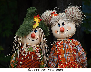 Two scarecrow dolls side by side