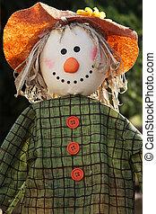 Scarecrow in the garden - Closeup of a scarecrow with ...