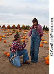Scarecrow proposes to hillbilly woman.