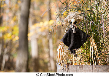 Scarecrow Protecting Green Plant with Copy Space