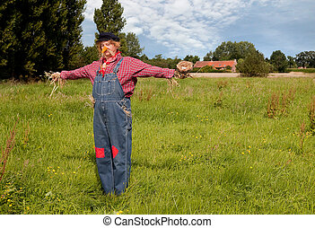 Farmer acting as a living scarecrow holding a bird's nest in his hand