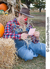 scarecrow with pink slip