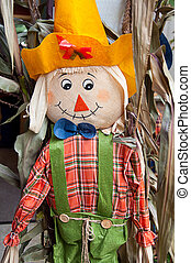 Scarecrow with yellow hat still life. Has corn husk hair and...
