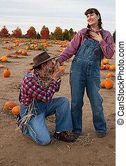 Scarecrow woos female farmer.