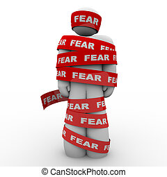 Scared Afraid Man Wrapped in Red Fear Tape - A man is...