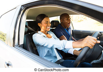 african girl taking driving lessons for the first time