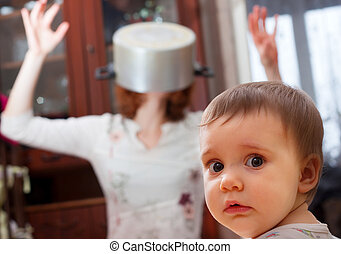 Scared baby against crazy mother - Portrait of scared baby...