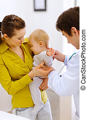 Scared baby on examination don't want to be checked by doctor