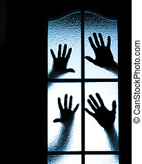 Scared boy behind glass door