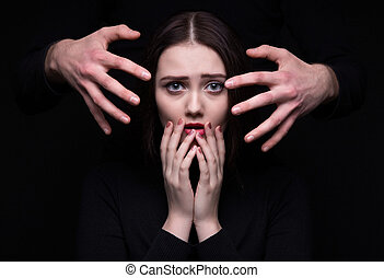 Scared brunette woman with hands
