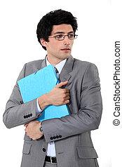 Scared businessman holding a folder