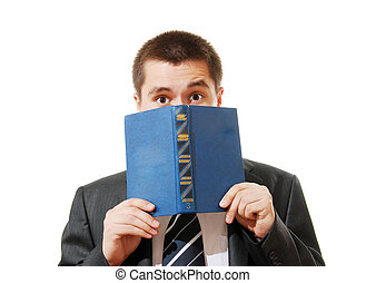 Scared businessman with a book closing his face