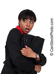 Scared businesswoman clutching folder