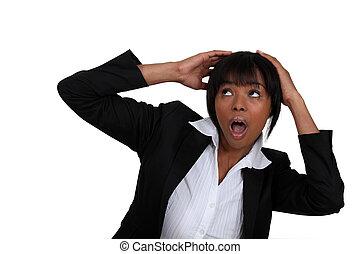 Scared businesswoman shielding her head