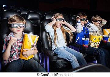 Scared Children Watching 3D Movie In Cinema Theater