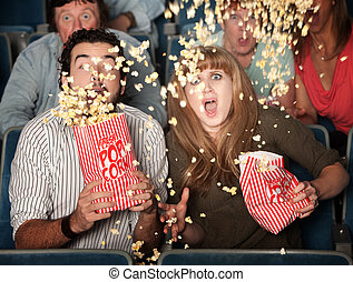 Scared Couple Spill Popcorn - Scared couple jump in their...