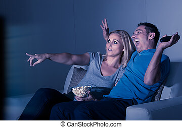 Scared Couple Watching Television