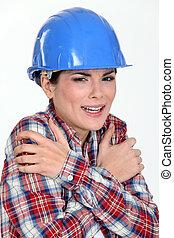 Scared female builder