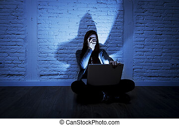 scared female teenager with computer laptop suffering...