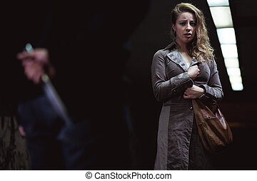 Scared for her life - Shot of a scared young woman looking...