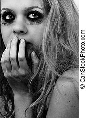 Scared girl with beautiful blond hair