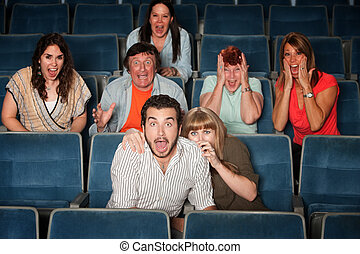 Scared Group - Scared group of people scream out in theater